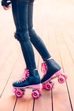 Legs of young roller skater standing on stage Royalty Free Stock Image