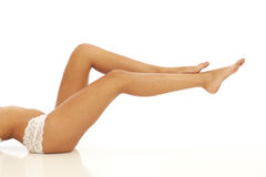 Legs of young woman Stock Image