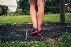 The legs of a young woman by fitness equipment Stock Photos