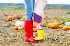 Legs of young woman and her little girl daugher in Royalty Free Stock Photography