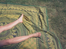 Legs of young woman relaxing outside on grass Royalty Free Stock Photo