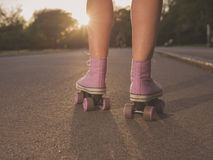 Legs of young woman roller skating in park Stock Photos