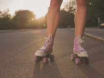 Legs of young woman roller skating in park Royalty Free Stock Photography