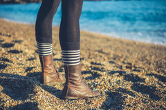 Legs of young woman standing on beach Royalty Free Stock Photos