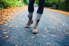 Legs of young woman walking in autumn Stock Photos