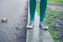 Legs of young woman walking outside Stock Photos