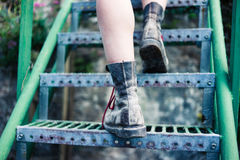 The legs of a young woman walking up stairs stock photos