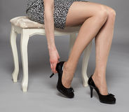 Legs of young woman wearing mini dress and high-heeled black sho Stock Photo