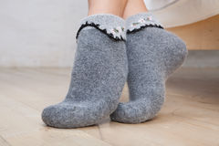 Legs of young woman wearing socks Royalty Free Stock Image