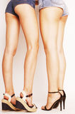 Legs of young women, pair of butts in jeans shorts Stock Photo