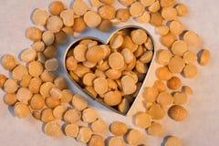 Legumbres sanas del corazón - guisantes partidos del amarillo Imagen de archivo