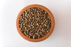Legume Roveja seeds. Legume Roveja in a wooden jar on white background Royalty Free Stock Photo