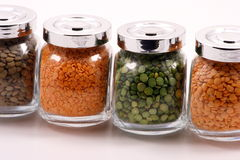 Legumes. Peas and lentils in containers stock image