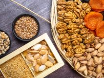 Legumes bean seed buckweat apricots nuts top view. Legumes bean seed buckweat apricots wheat nuts top view, healthy snack royalty free stock image