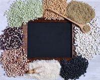 Legumes with blackboard. Royalty Free Stock Photography