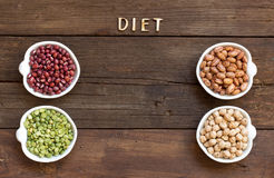Legumes in bowls and the word Diet Royalty Free Stock Photos