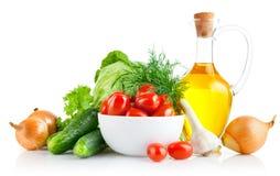 legumes frescos ajustados com petróleo verde-oliva Imagens de Stock