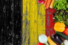 Legumes frescos de B?lgica na tabela Cozinhando o conceito no fundo de madeira da bandeira foto de stock royalty free