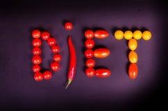 Legumes frescos em uma tabela preta Faça dieta o conceito Foto de Stock