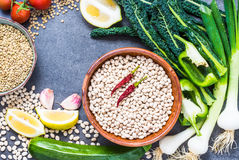 Legumes and fresh vegetables background. Stock Photography