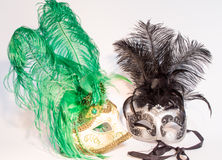 Two Venetian carnival masks over white background stock photo