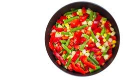 Legumes misturados em uma frigideira Vista superior Isolado Imagem de Stock Royalty Free