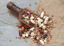 Legumes mix in the wood spoon Stock Photos