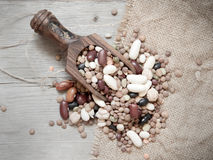 Legumes mix in the wood spoon Royalty Free Stock Images