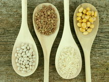 Legumes over spoons Stock Image