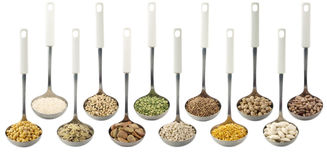 Legumes over spoons Stock Photo