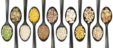 Legumes over spoons royalty free stock image