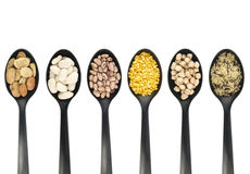 Legumes over spoons Royalty Free Stock Images