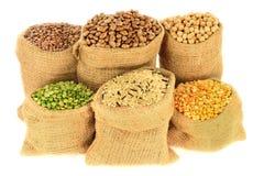 Legumes, Pulses in burlap bags royalty free stock photos