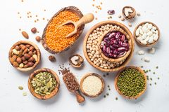 Legumes. seeds and nuts on white. Vegan protein source. Legumes - lentils, chickpeas, beans, green mung bean, seeds and nuts on white background. Top view stock image