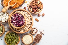 Legumes. seeds and nuts on white. Vegan protein source. Legumes - lentils, chickpeas, beans, green mung bean. seeds and nuts on white background. Top view copy royalty free stock photos