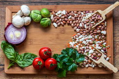 Legumes And Vegetables. Dried Food; Mixed Legumes in the kitchen and vegetables Royalty Free Stock Photos