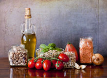 Legumes and vegetables on the kitchen table royalty free stock images