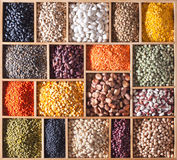 Legumes in a wooden box stock photos