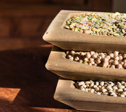 Legumes in wooden containers Stock Photos