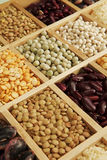 Leguminous collection. Variation of different beans, lentils and peas in wooden box stock photos