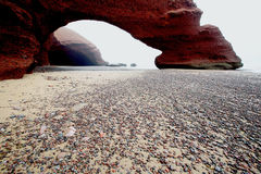 Legzira Rock Arch. Rock Arch at Legzira Beach, Morocco, Africa Stock Photos