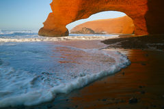 Legzira stone arches, Atlantic Ocean, Morocco. Legzira dramatic natural stone arches reaching over the sea, Atlantic Ocean, Morocco, Africa Stock Photo