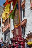 Buddhist Monks unveil the Thangka- A Tibetan Buddhist painting of Lord Padmashambhava. Leh city,Ladakh, India.Date: 07/03/2017.Buddhist Monks unveil the Thangka royalty free stock images