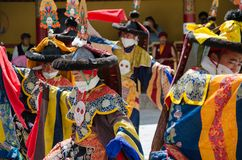 Masked dancers in traditional Ladakhi Costume performing during the annual Hemis festival royalty free stock photo