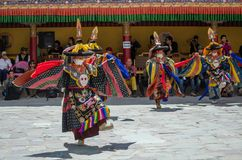 A group of Masked dancers in traditional Ladakhi Costume performing during the annual Hemis festival stock image
