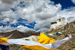 Leh gompa and lungta prayer flags, Ladakh Stock Photography