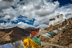 Leh gompa and lungta prayer flags, Ladakh Stock Images