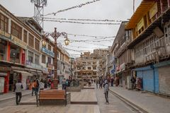 Crowd of people in Main Bazar market, Leh City, India. Leh, India : April 2019 - Crowd of people with Buddhist Tibetan prayer flag and lot of survinior shop on stock images