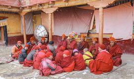 Assembly of Old and young lama during snow fall at temple in the Royalty Free Stock Photo