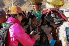 Ladakhi women look at their photo in camera of foreign tourist Royalty Free Stock Image